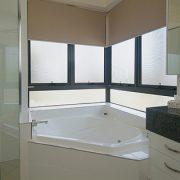 Awning windows near bathtub in the bathroom