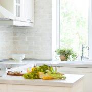 White bi fold windows over a sink in a modular kitchen