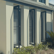 3 Casement Windows of a house with small garden
