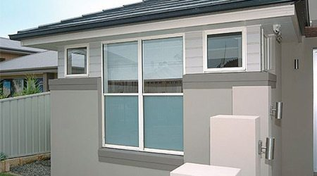 External view of house with double hung windows