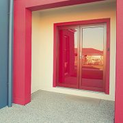 Red frame french hinged doors in a house