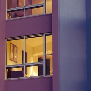 Outside view of purple apartment building using aluminium windows