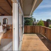 Angular view of timber balcony opening into living space