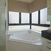 Awning windows near bathtub in the bathroom