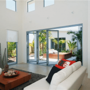 Bi-fold doors opening to an indoor garden area