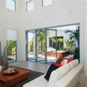 Bi-fold doors opening to an indoor garden area