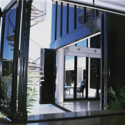 Tinted aluminium bi fold doors at the entrance of a house