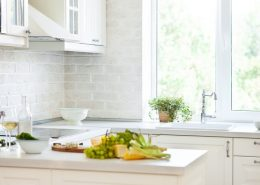 White bi fold windows over a sink in a modular kitchen