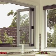Open white frame aluminium bi-fold windows in a kitchen