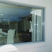 Outside view of a fixed lite window looking into the dining area