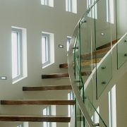 Series of fixed lite windows leading up a staircase