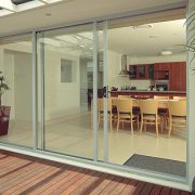 External view of white modular kitchen with sliding doors